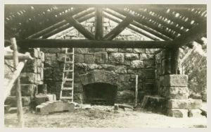 Interior showing completed fireplace wall with log roof in progress. Barbara Teyssier Forrest Collection.