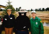 Dick Henderson and Chet Nolte with Smokey Bear at Evergreen Earth Day.