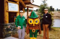 Chet Nolte, left, and Dick Henderson with Woodsy Owl at the Evergreen Earth Day Fair.